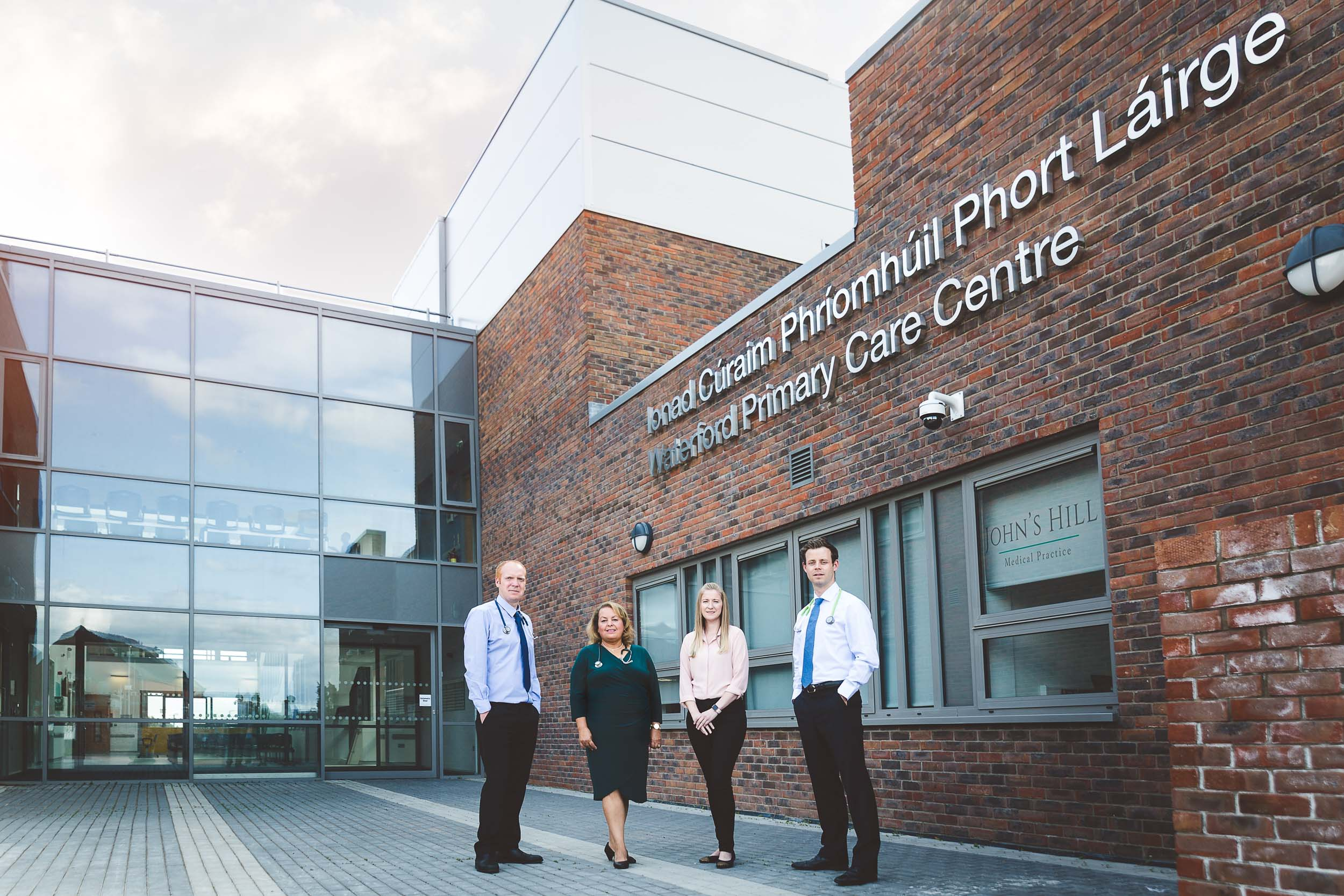 Outside the John's Hill Medical Practice Dr Paul Campbell Dr Hebat Seiam Nurse Aoife and Dr Paul O'Hara
